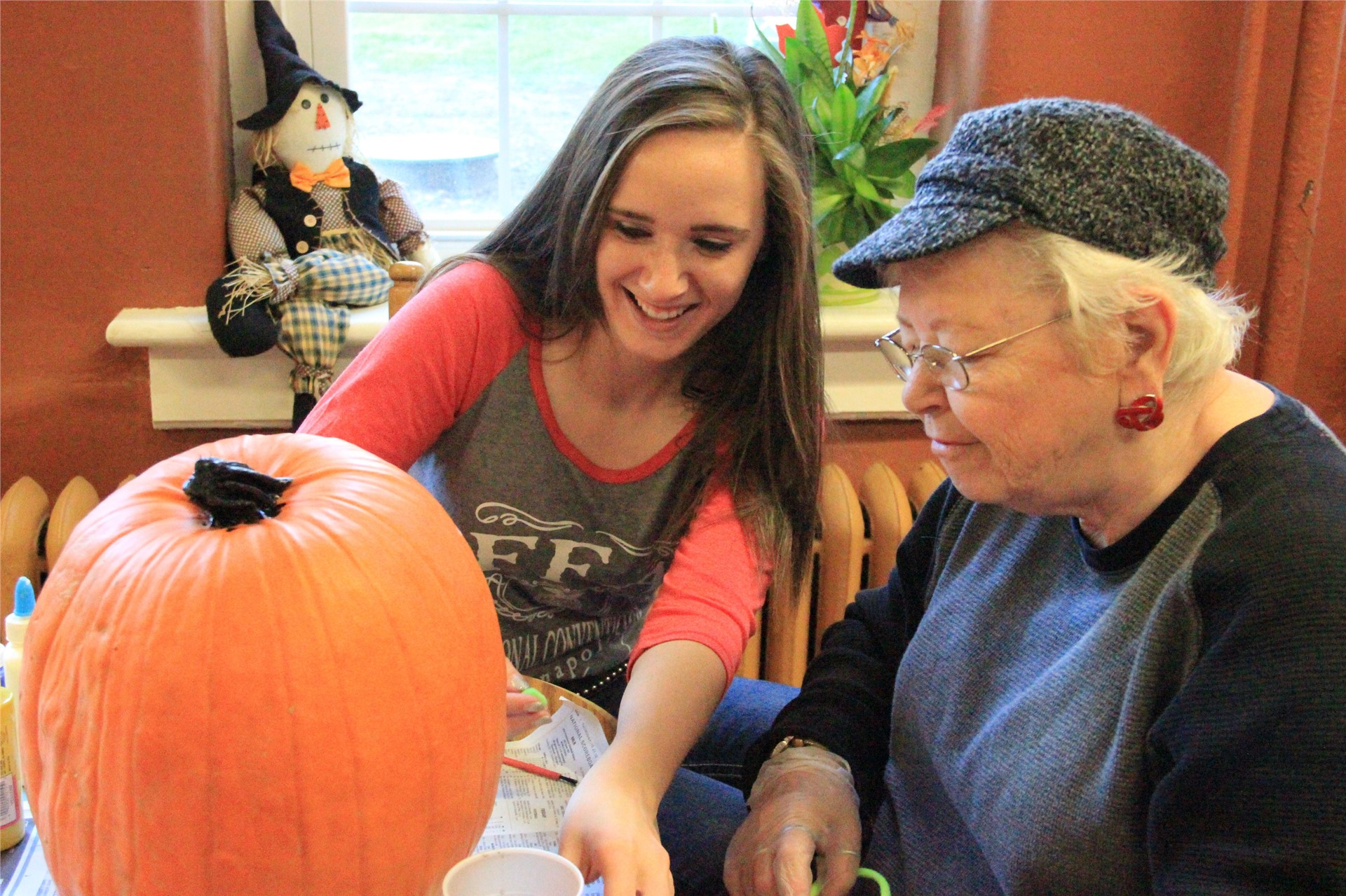 FFA decorates pumpkins with Fairview Assisted Living residents