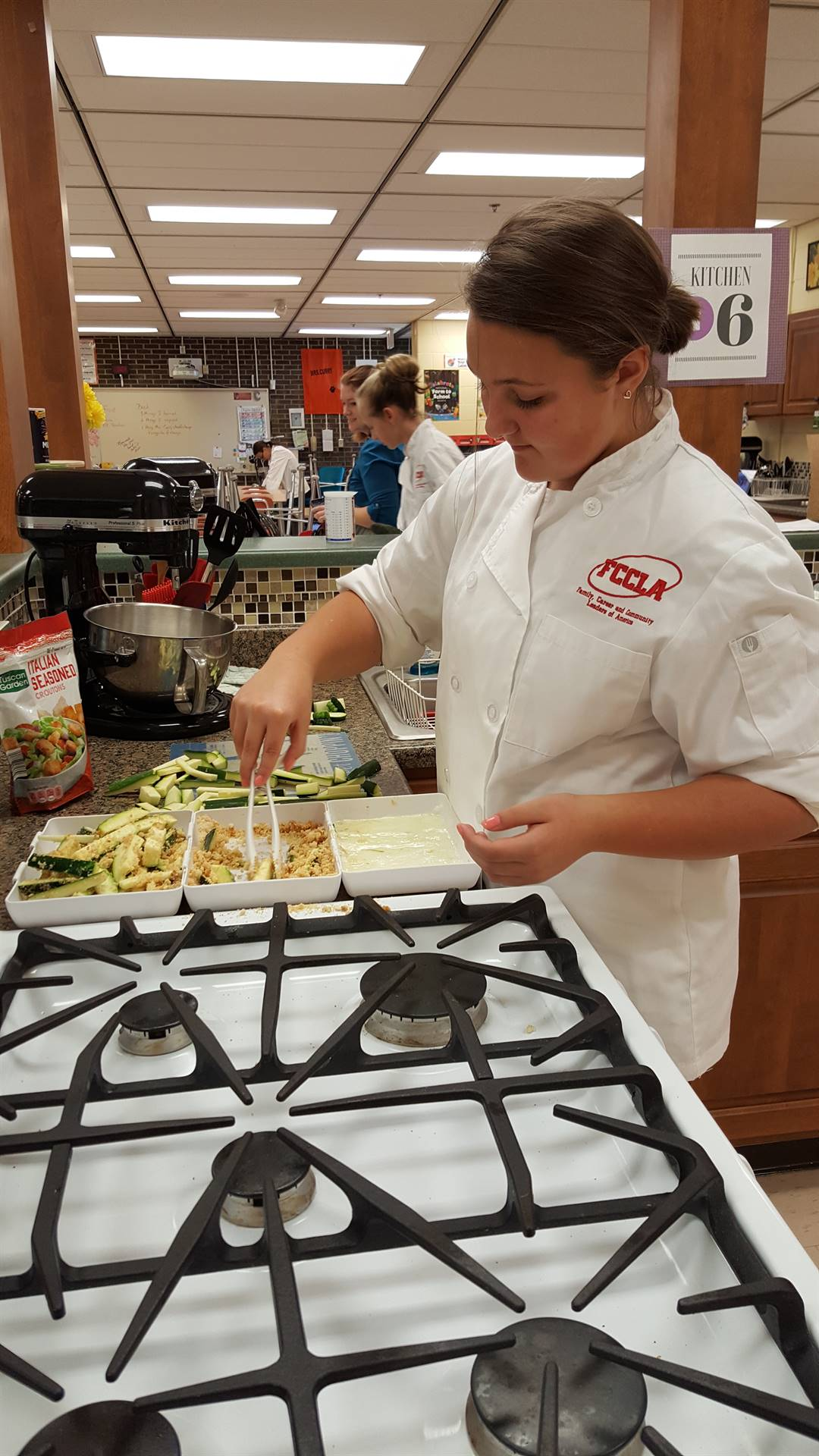 FCCLA member preparing zucchini fries at a recent fundraiser.