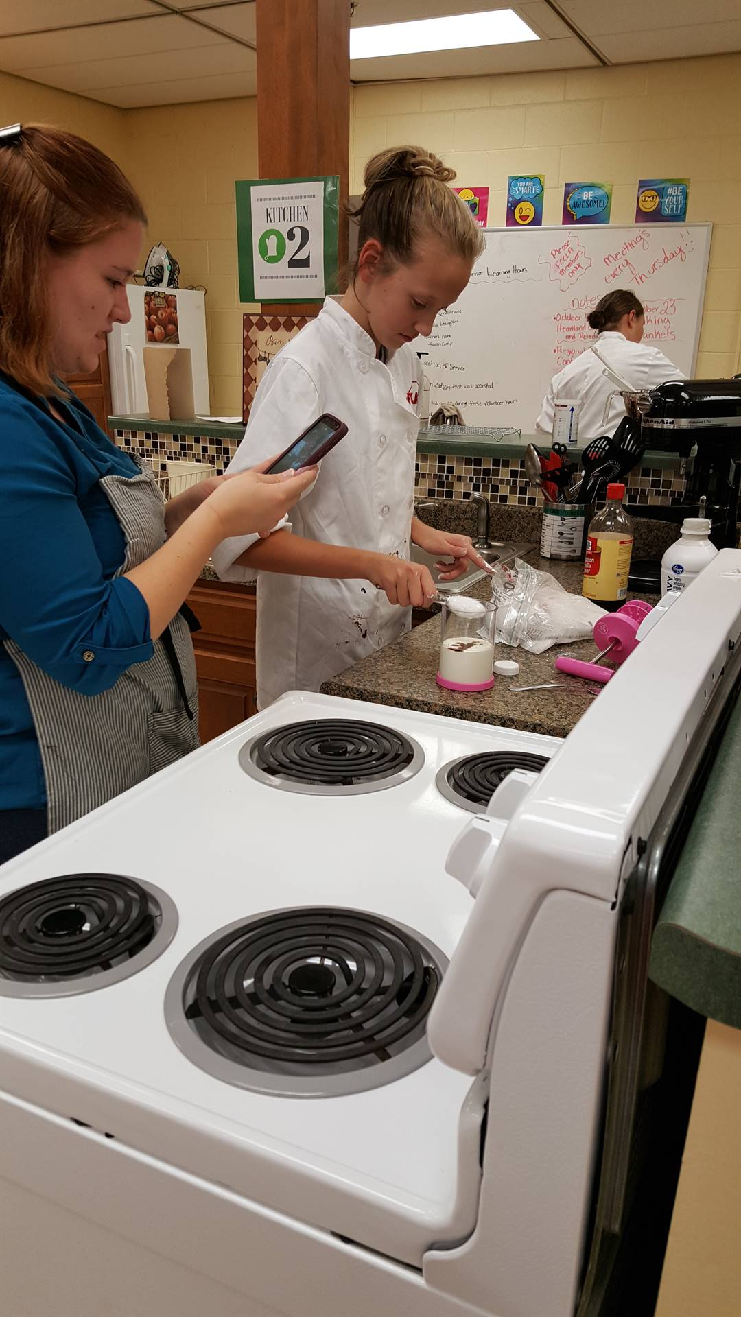 FCCLA member preparing whipped cream at a recent fundraiser.