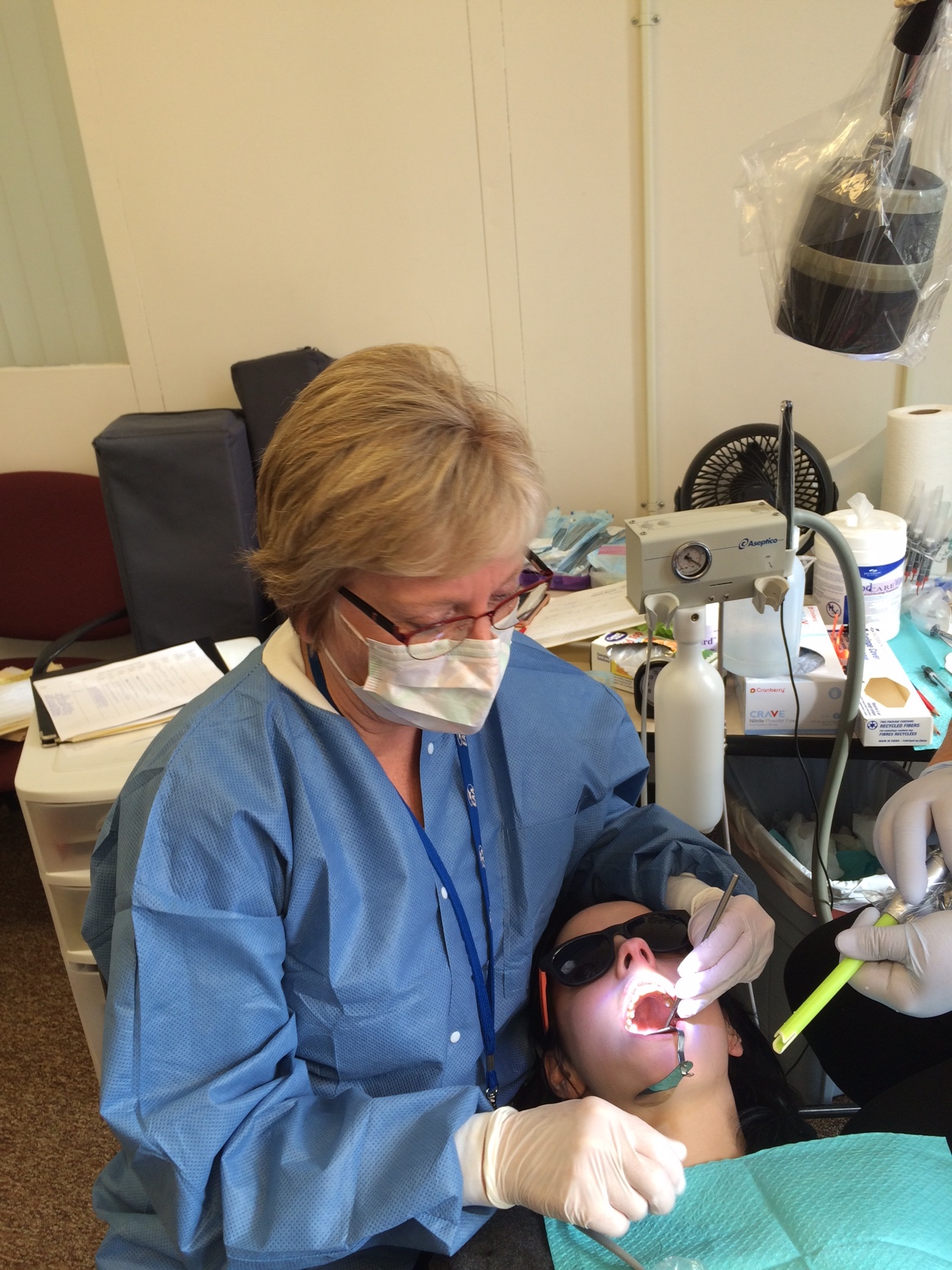 Students receiving dental care and instruction.