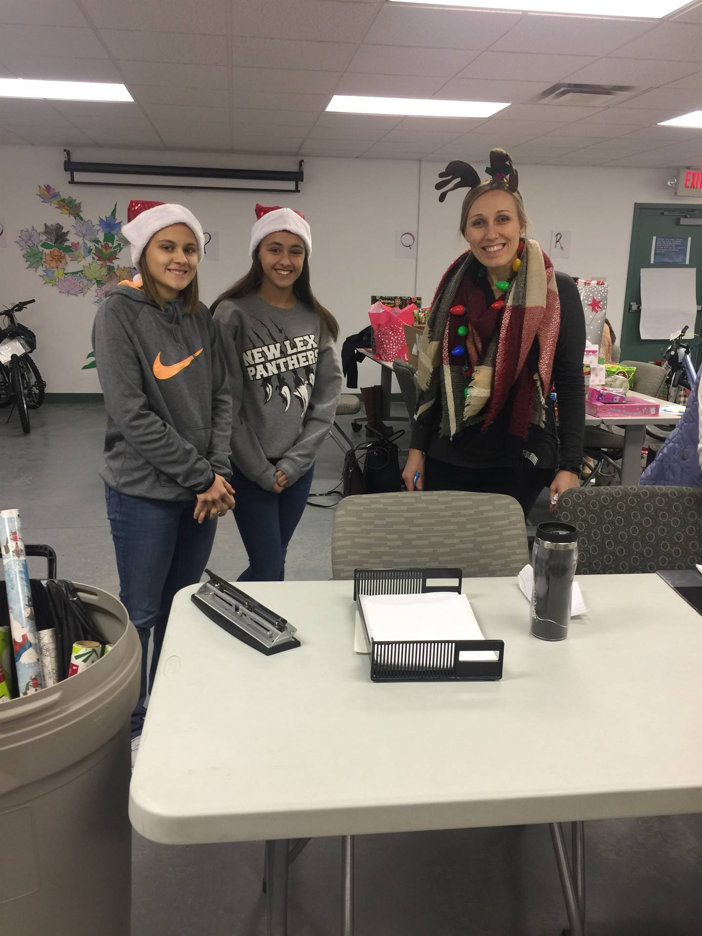 Afterschool students volunteering at the Angel Tree gift distribution day.