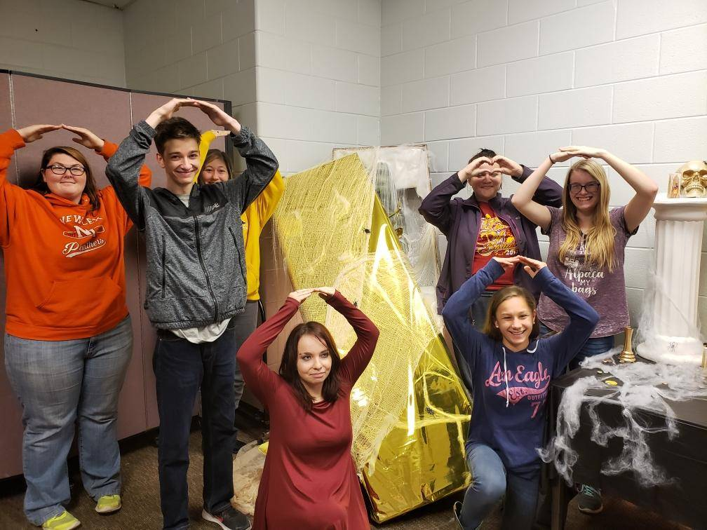 Team members participating in the Spotlight on Afterschool mummy escape room.