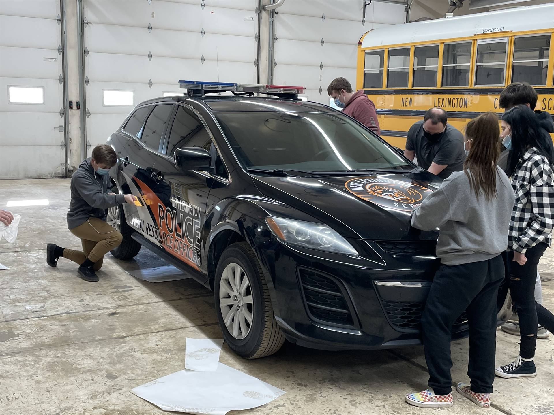 Mr. Harvey's Fab Lab working on Officer Gibb's New Car